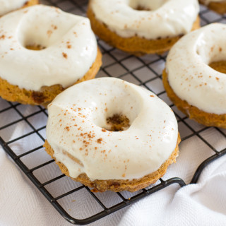 Skinny Pumpkin Cinnamon Chip Donuts with Maple Cream Cheese Glaze | www.themessybakerblog.com