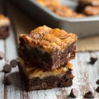 Turtle Cheesecake Swirl Brownies from www.themessybakerblog.com