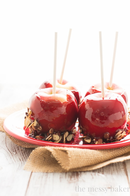 Red Moscato Candied Apples Dipped in Toasted Almonds and Semi-Sweet Chocolate | www.themessybakerblog.com