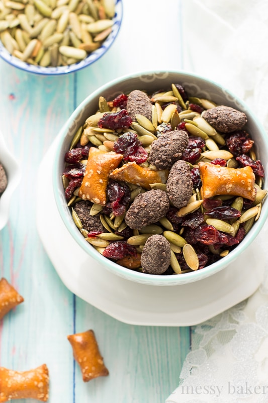 Easy Fall Trail Mix recipe made with pumpkin seeds, dried cranberries, peanut butter filled pretzels, and dark chocolate covered almonds | www.themessybakerblog.com