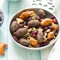 Easy Fall Trail Mix made with pumpkin seeds, dried cranberries, peanut butter filled pretzels, and dark chocolate covered almonds | www.themessybakerblog.com