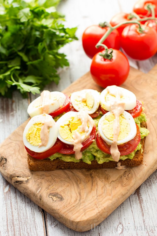 Healthy Avocado, Tomato, and Sliced Egg Toast. This open-faced sandwich is perfect for breakfast or lunch.