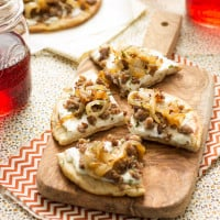 Sausage & Caramelized Onion Pita Pizza | www.themessybakerblog.com