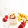 Strawberry Banana Overnight Oats | A creamy mixture of Greek yogurt, vanilla almond milk, fresh fruit, and oats. This healthy breakfast tastes like a decadent dessert.