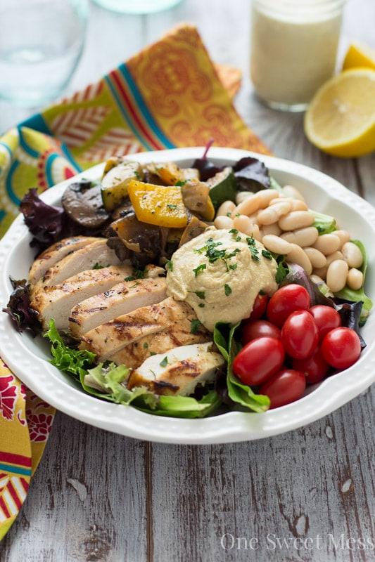 Mediterranean Chicken & Grilled Veggie Salad with Hummus and Lemon Tahini Dressing