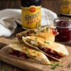 Turkey, Stuffing & Cranberry Quesadilla: All the Thanksgiving leftovers get stuffed between a toasted flour tortilla with smoked cheese.