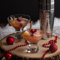 Spiced Cranberry Rum Old-Fashioned: Spiced rum, tart cranberry juice, and warm cinnamon and cloves get shaken to create a festive holiday cocktail perfect for celebrating New Year's Eve.