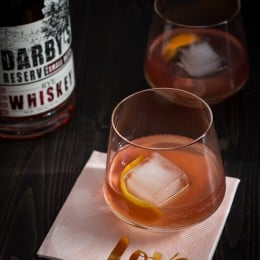 The Tiny Dancer Cocktail: This fierce but delicate cocktail combines bourbon, Campari, and blood orange juice.