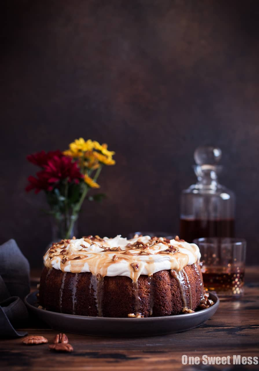 Sweet Potato Bundt Cake with Marshmallow Frosting and Bourbon Pecan Caramel Drizzle