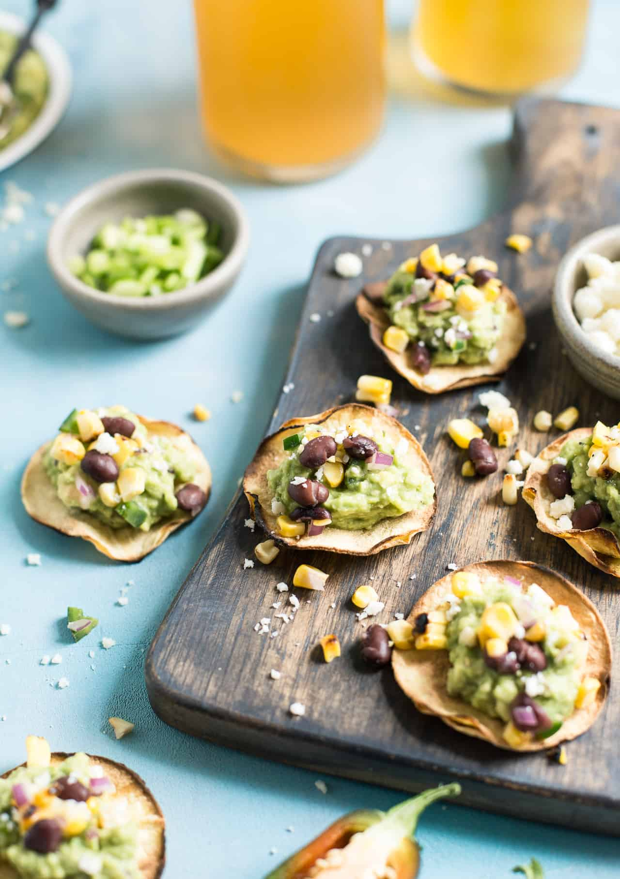 Grilled Corn Salsa & Guacamole Tostadas: This crispy bite-sized appetizer is perfect for football season. They're gluten-free and healthy with a vegan option.